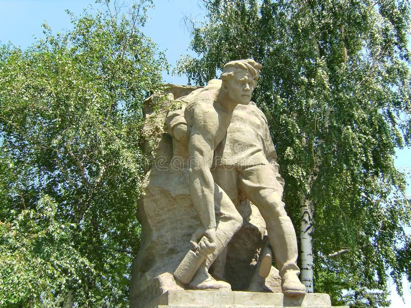 Mamaev kurgan. Heroes` Square. Sculpture `We conquered death`- soldier is seriously wounded, but is ready to fight to the end. royalty free stock images
