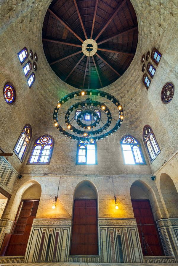 Mamluk era Sultan al Ghuri Mausoleum with decorated marble floor, stained glass windows, and bricks stone wall, Cairo, Egypt stock image