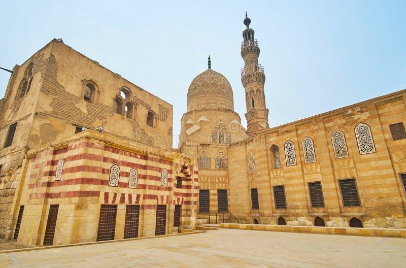 Explore Amir Khayrbak complex, Cairo, Egypt. Mamluk style architecture of the medieval Amir Khayrbak complex, built in Ottoman Era and located in Al Wazir street stock image