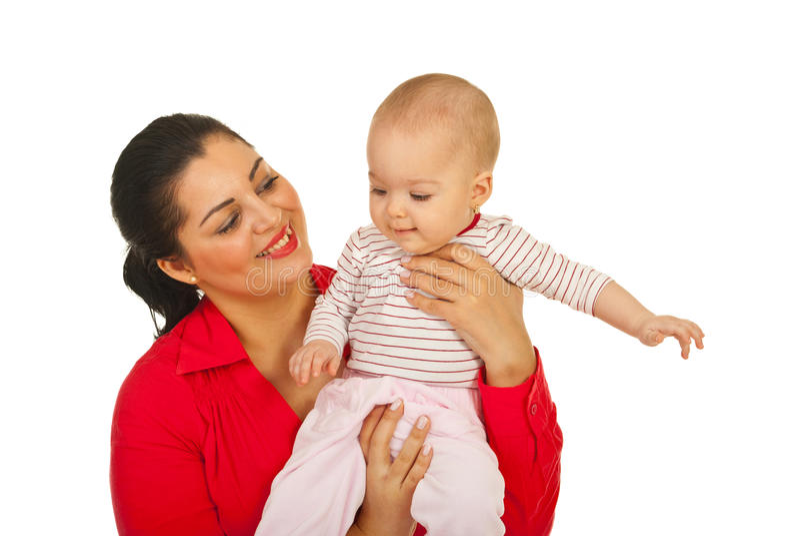 Mamma felice che gioca con la sua neonata fotografia stock libera da diritti