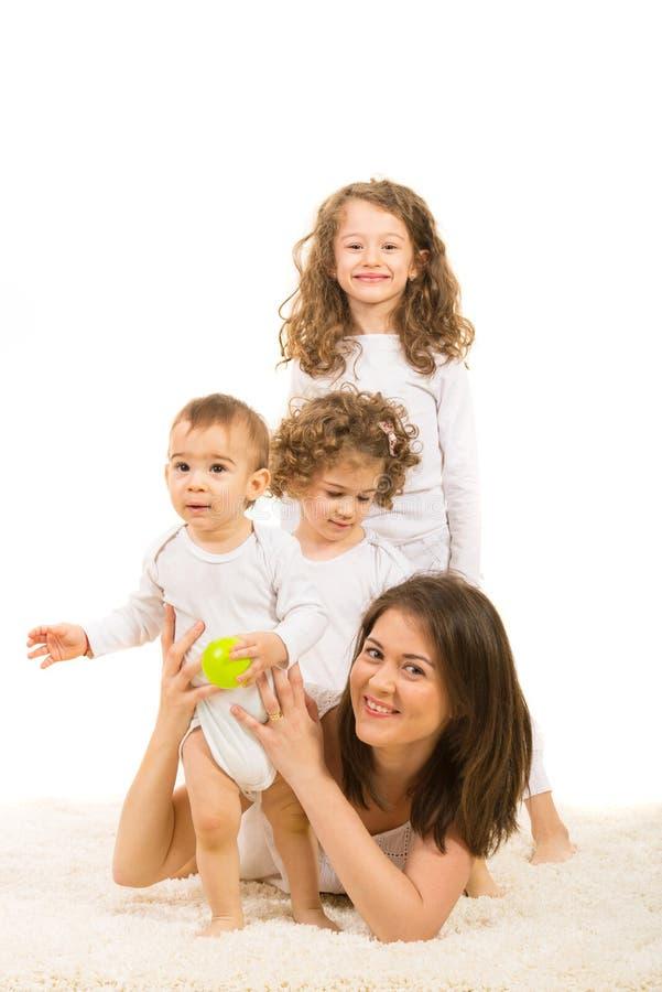 Mamma felice con tre bambini fotografia stock libera da diritti