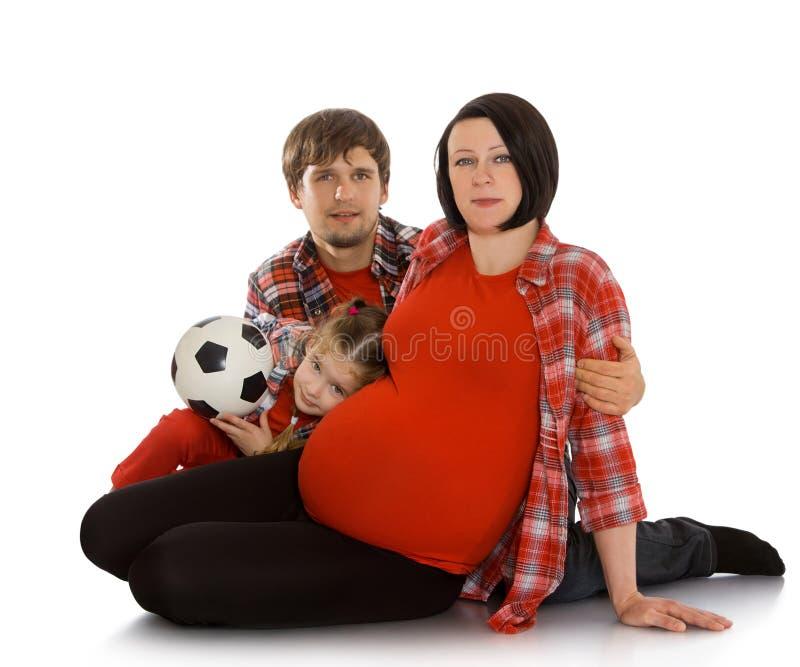 Mamma incinta con la sua famiglia fotografia stock