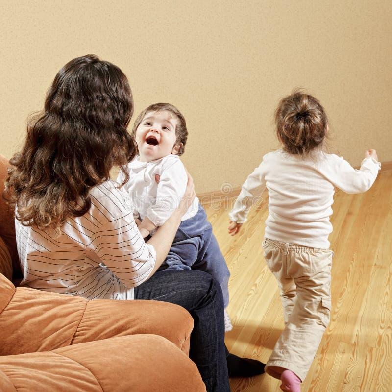 Mamma mit Töchtern stockbilder