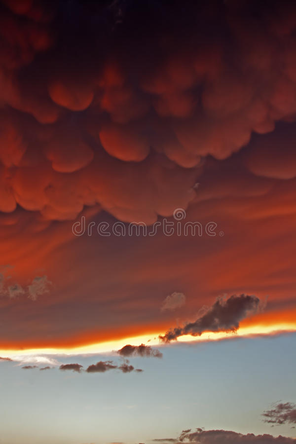 Mammatus clouds at sunset ahead of violent thunderstorm royalty free stock photo