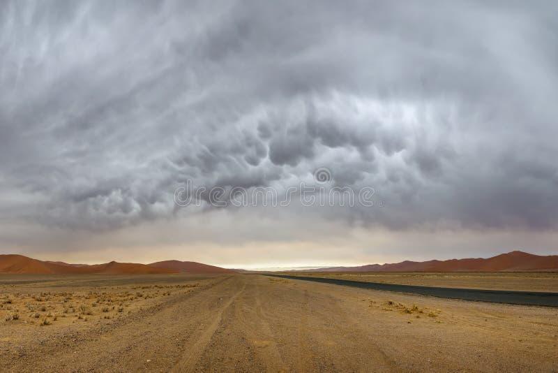 Mammatus stormy clouds over Sossusvlei dunes stock photos