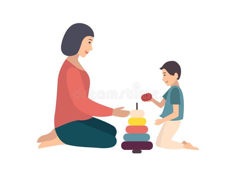 Mamy i syna obsiadanie na ostrosłupie wpólnie Macierzysty nauczanie jej chłopiec bawić się z zabawką śmieszny royalty ilustracja