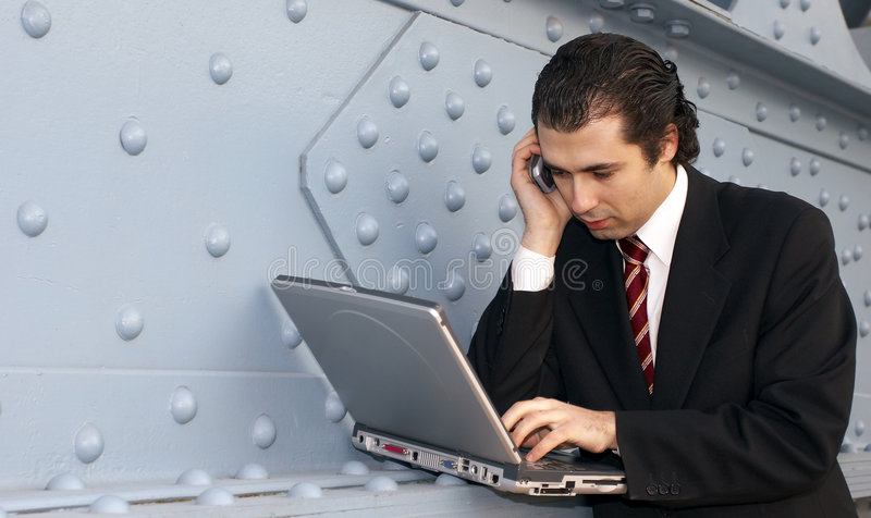 Man. In grey suit, with laptop royalty free stock photography