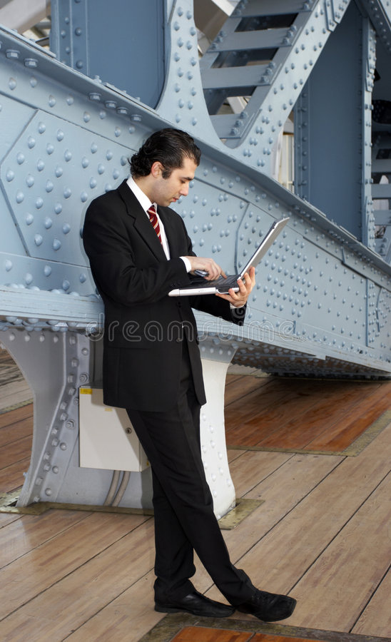 Man. In grey suit, with laptop royalty free stock images
