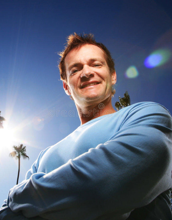 Man. Confident man outdoors over blue sky stock photography