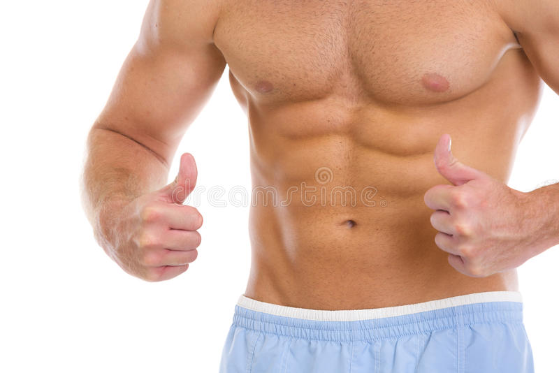 Man with abdominal muscles showing thumbs up. Closeup on man with abdominal muscles showing thumbs up stock photos