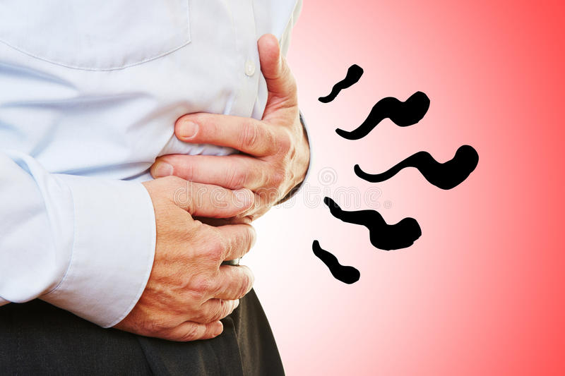 Man with abdominal pain in stomach. Holding hands on his belly stock image