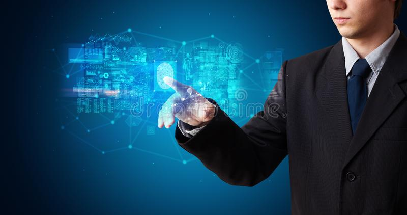 Man accessing hologram with fingerprint royalty free stock images