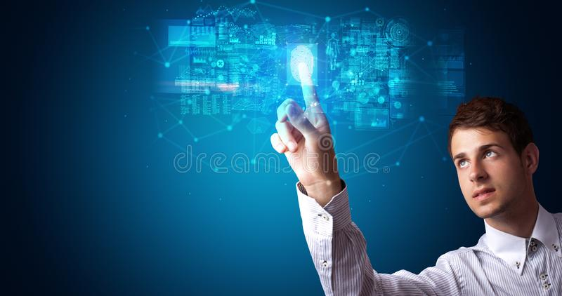 Man accessing hologram with fingerprint stock photo