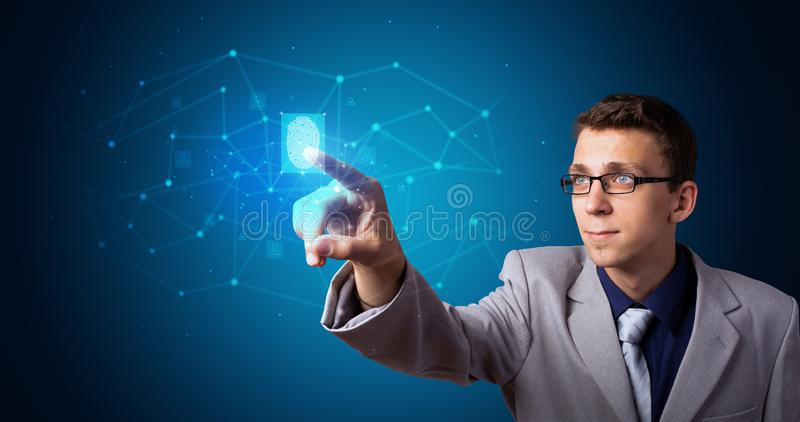 Man accessing hologram with fingerprint stock photo
