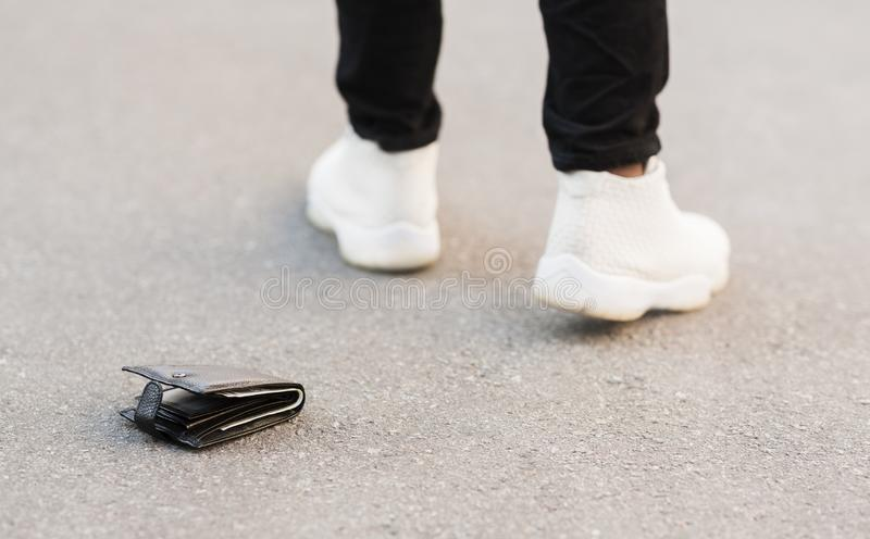 Man accidently dropped his leather wallet with money royalty free stock photos