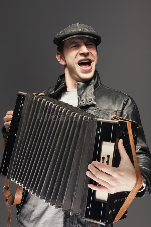 Man with accordion. Man is singing songs and playing the old accordion stock images