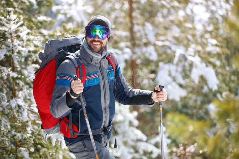 Man in action with hiking equipment stock photography