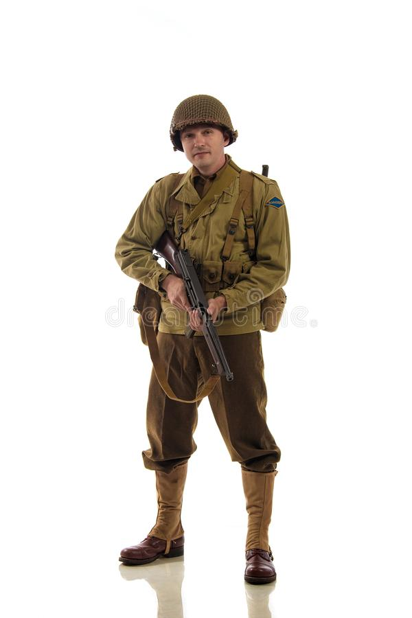 Man actor in military uniform of American ranger of World War II period. Posing against white background stock image