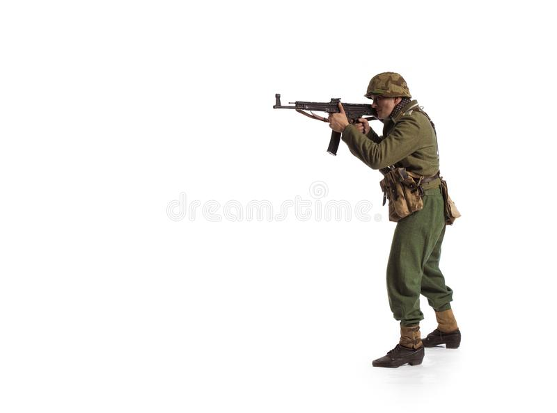 Man actor in the movie role of an old military man WWII. Posing against white background stock image