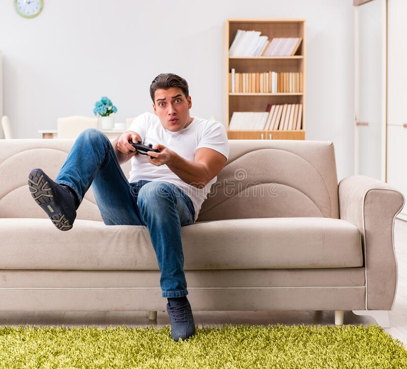 Man addicted to computer games royalty free stock image
