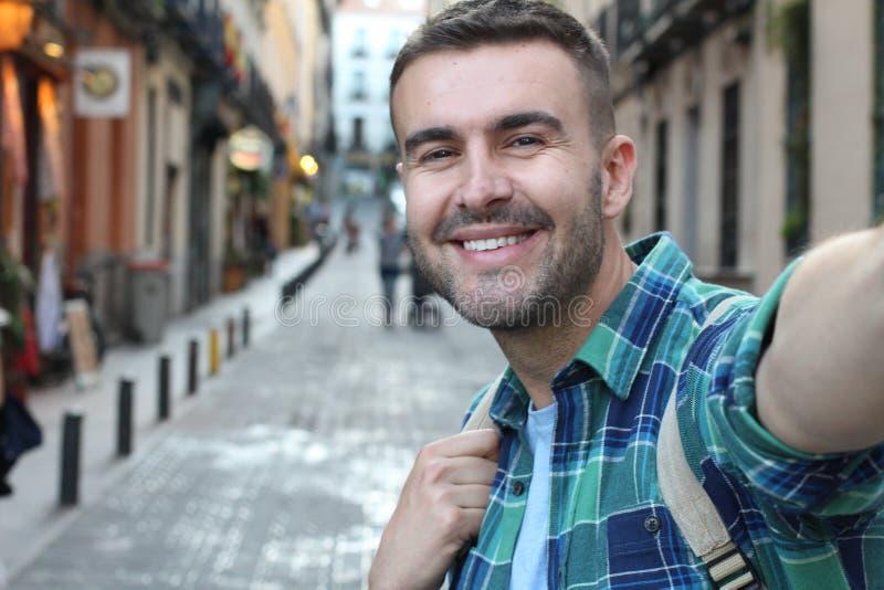 Man addicted to taking selfies royalty free stock image