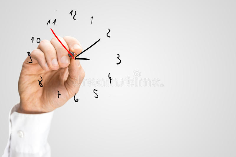 Man adding a second hand to a hand-drawn clock royalty free stock images