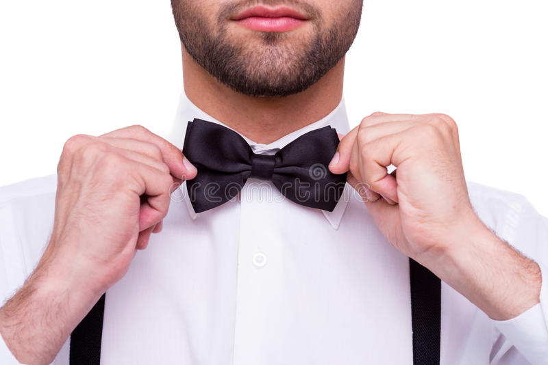 Man adjusting bow tie. royalty free stock photos