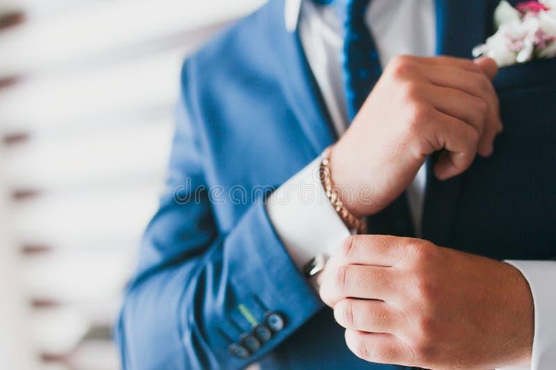 Man adjusting sleeve cuff stock photos