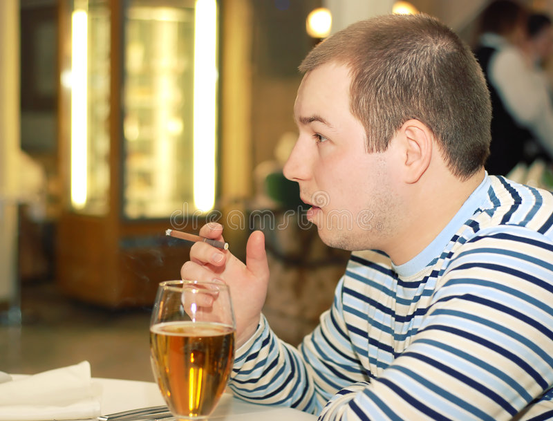 Man adult drink beer and smoke cigarette