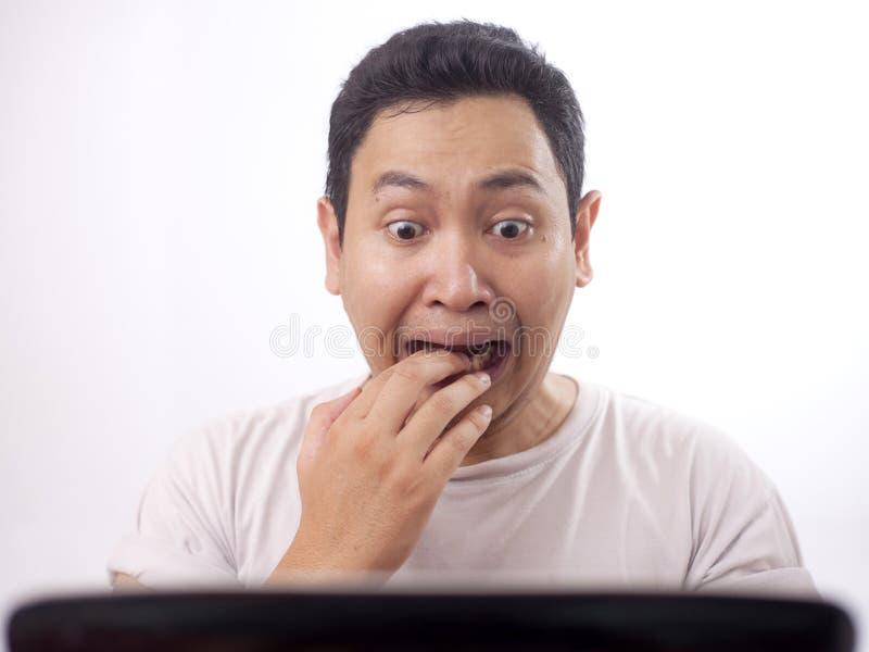 Man Afraid When Looking at Laptop royalty free stock photos