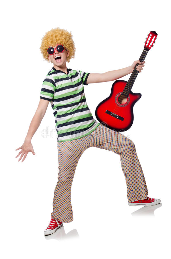 Man with afro wig. With guitar on white stock image