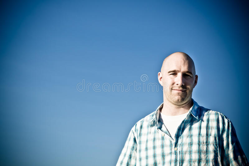 Man against blue sky stock images