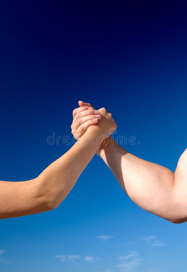 Man Against Woman in Arm Wrestling stock photo