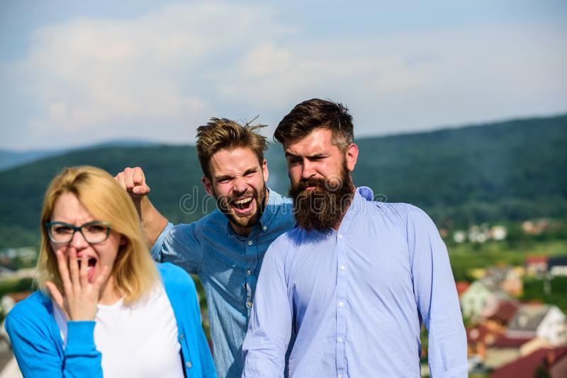 Man aggressive going to attack lover of his girlfriend. Boyfriend full of jealous looks suspiciously at couple. Jealous stock image