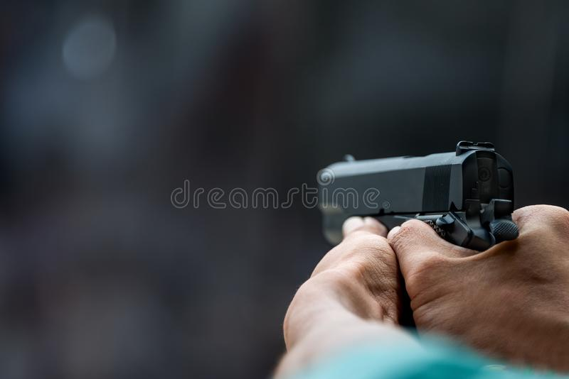 Man aiming gun ready to shoot for protect and security stock photography