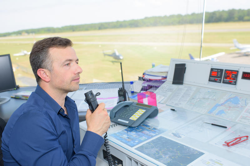 Man in air control tower. Man in the air control tower stock photography