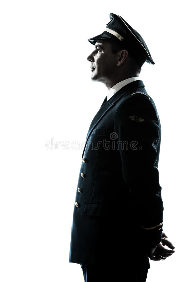 Man in airline pilot uniform silhouette. One caucasian man in airline pilot uniform silhouette in studio isolated on white background royalty free stock image