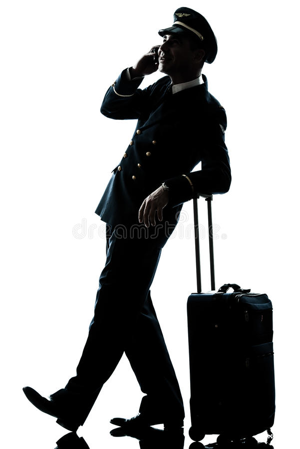 Man In Airline Pilot Uniform Silhouette Stock Images