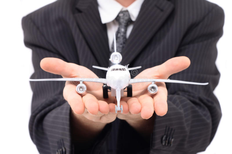 Man and airplane. Isolated on the white background stock image