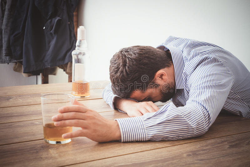 Man alcohol addicted feeling bad stock photos