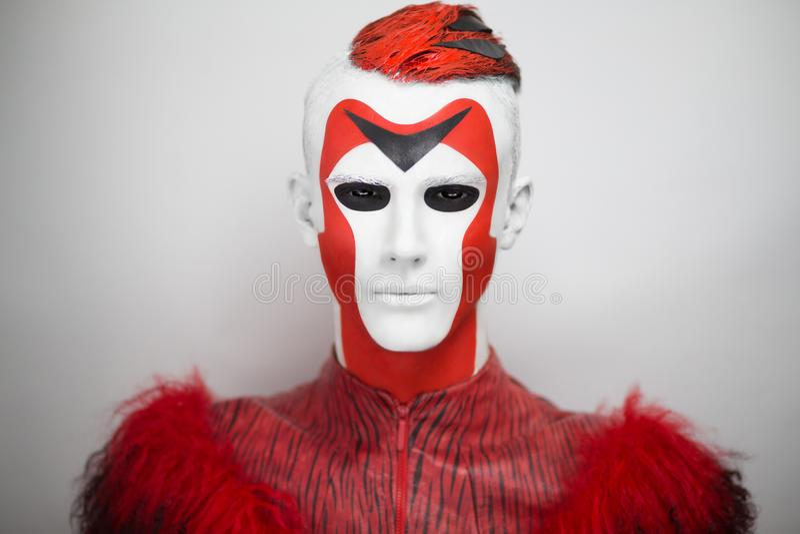 Man Alien red white face stock images