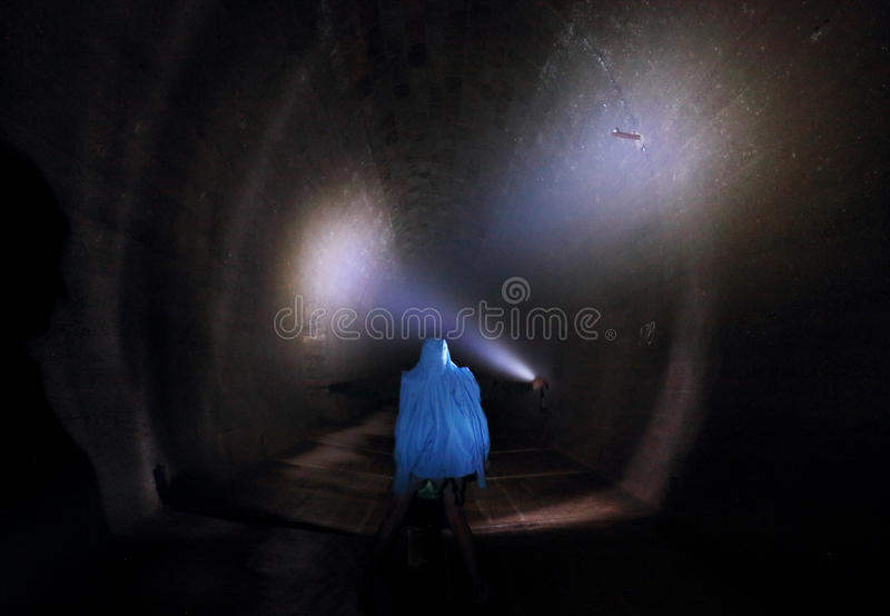 Man alone in dark tunnel, Horror stock photos