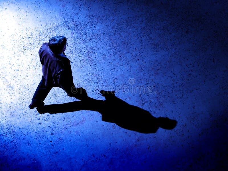 Man Alone at Night on Street royalty free stock photo