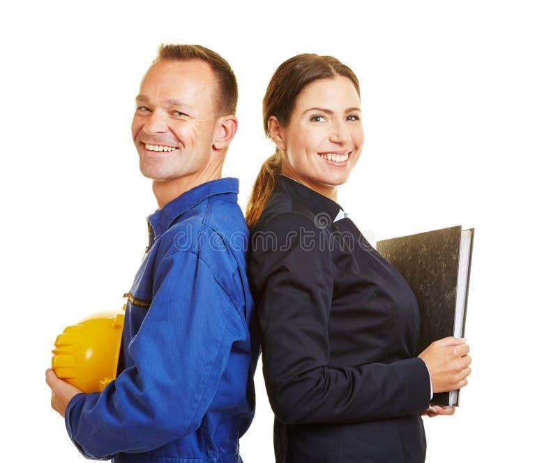 Man als arbeider en vrouw als bedrijfsberoeps royalty-vrije stock fotografie