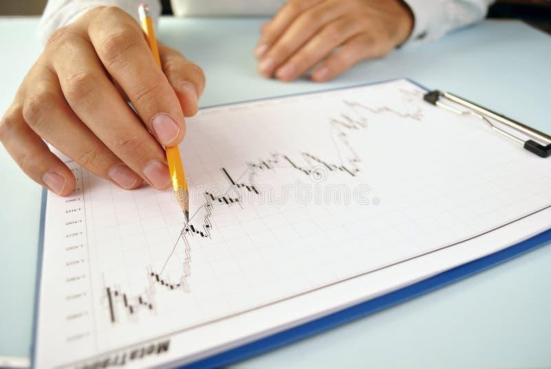 Man analysing an upward trending graph stock images