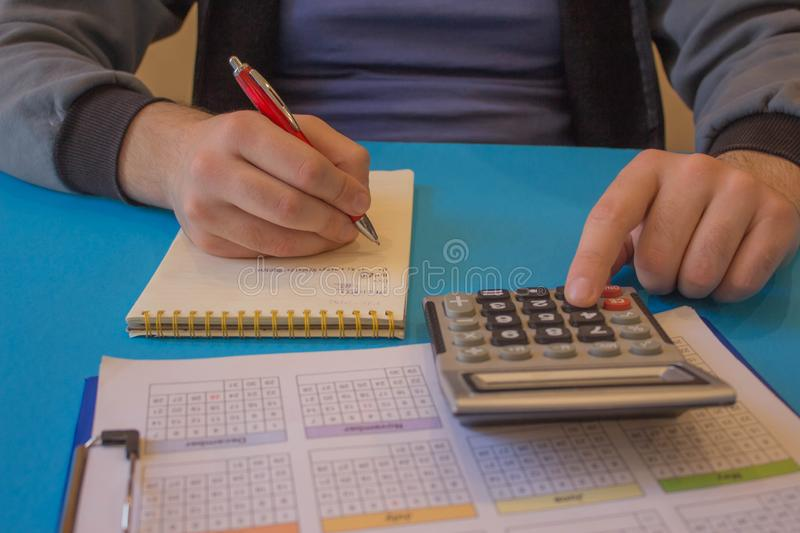 Man Analyzing Statistics Financial Concept. The calculators, business owners, accounting and technology stock photography