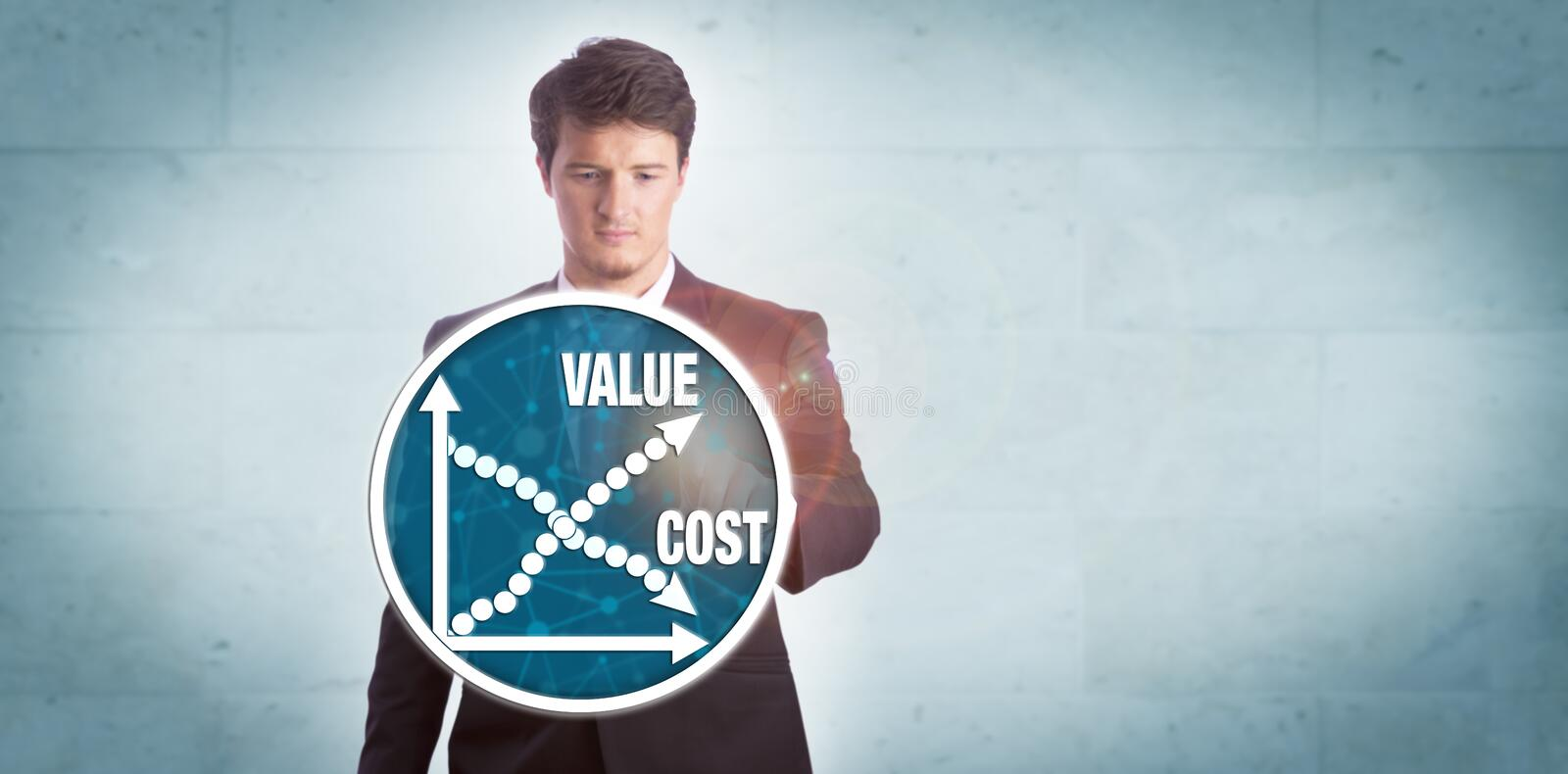 Man Analyzing Value Growth Versus Cost Reduction. Young businessman touching chart icon depicting growth of value versus reduction of cost. Technology and stock image