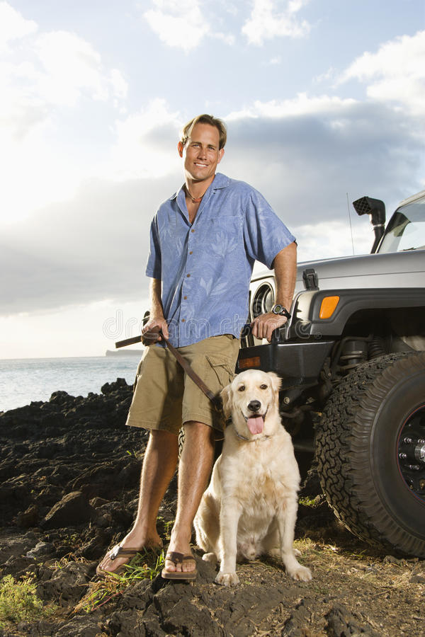 Free Man And Dog By SUV At The Beach Royalty Free Stock Photos - 12732798