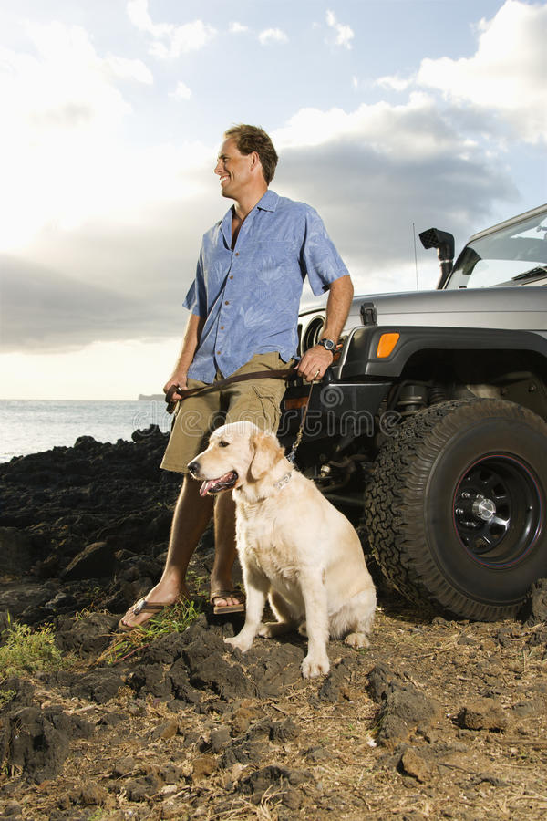 Free Man And Dog By SUV At The Beach Royalty Free Stock Photos - 12732938
