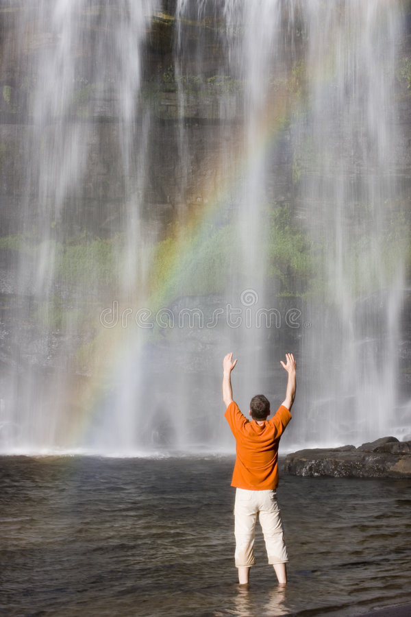 Free Man And Waterfall With Rainbow Royalty Free Stock Photos - 4374118